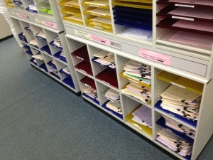 The processed applications are piling up! They are divided by preferred school.