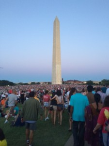 People gathering in anticipation of the firework show over the reflecting pool.