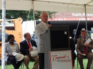 Mayor Padgett makes remarks at the Concord City Hall Groundbreaking Ceremony. Seated to the right is City Manager Brian Hiatt.