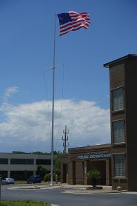 Flagpole with U.S. flag next to public safety building